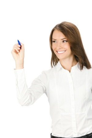 writing on glass: Happy smiling cheerful young business woman writing or drawing on screen with blue marker, isolated on white background