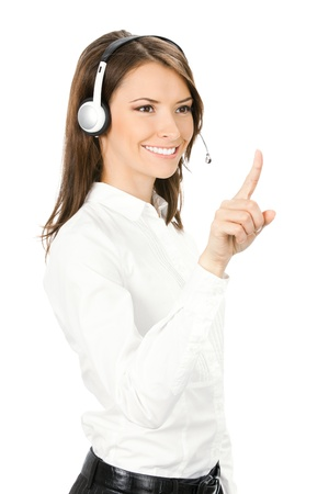 Portrait of happy smiling cheerful customer support phone operator in headset pointing at something, isolated on white background Stock Photo - 10024942