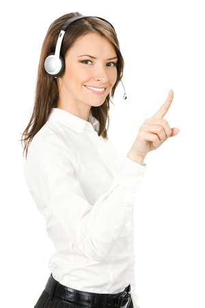 Portrait of happy smiling cheerful customer support phone operator in headset pointing at something, isolated on white background Stock Photo - 10024941