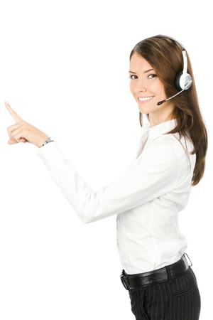 Portrait of happy smiling cheerful customer support phone operator in headset pointing at something, isolated on white background Stock Photo
