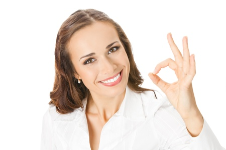Happy smiling young business woman with okay gesture, isolated on white background Stock Photo - 10024974