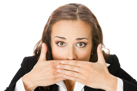 hand over: Portrait of surprised excited young business woman covering with hands her mouth, isolated on white background