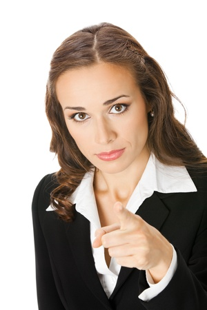 Portrait of young serious business woman pointing finger at viewer, isolated on white background photo