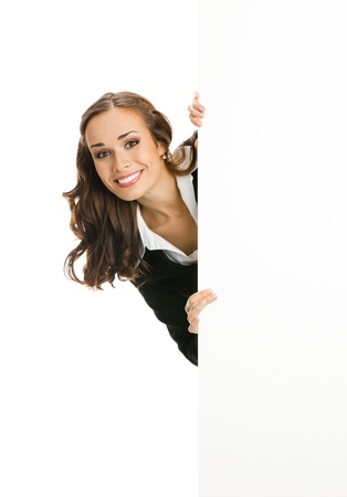 blank area: Happy smiling young business woman showing blank signboard, isolated on white background Stock Photo