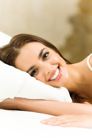 lazyness: Portrait of young happy smiling beautiful woman waking up at home