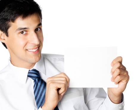 Portrait of happy smiling young businessman showing blank signboard, isolated on white background photo