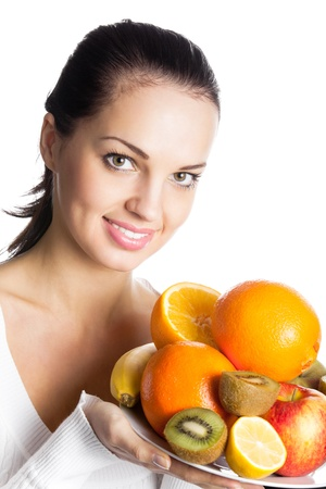Portrait of young happy smiling woman with plate of fruits, isolated on white background Stock Photo - 10087660
