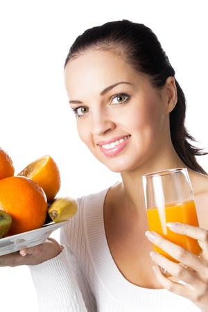 Portrait of happy smiling young woman with assorted citrus fruits and glass of orange juice, isolated on white background photo