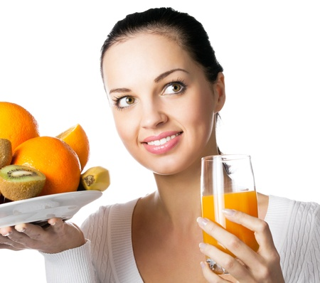Portrait of happy smiling young woman with assorted citrus fruits and glass of orange juice, isolated on white background Stock Photo - 10087580