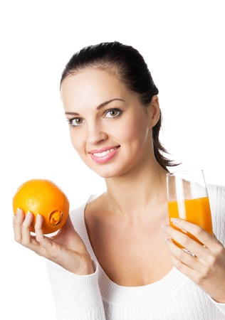 Portrait of happy smiling young woman with orange and glass of orange juice, isolated on white background photo