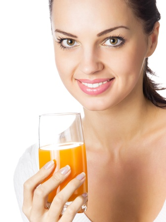 Portrait of happy smiling young woman with glass of orange juice, isolated on white background photo