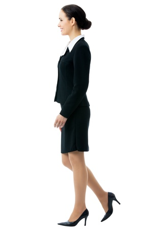 people walking white background: Photo of going businesswoman, isolated on white background