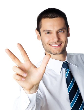 three people only: Portrait of happy smiling businessman showing three fingers, isolated on white background