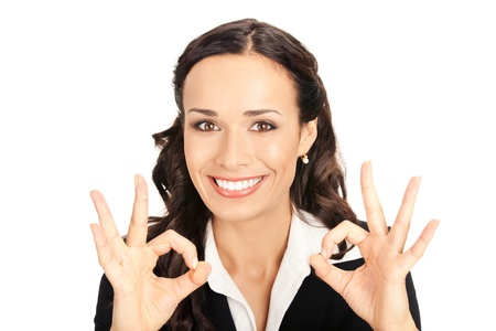 Happy smiling young business woman showing okay gesture, isolated on white background Stock Photo - 10290886
