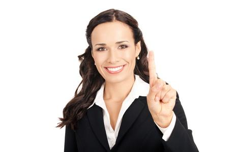 numero uno: Feliz sonriente joven empresaria mostrando un dedo, aislado sobre fondo blanco