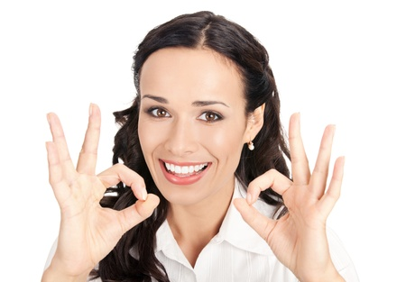 Happy smiling young business woman showing okay gesture, isolated on white background photo