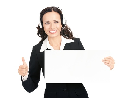 Happy smiling young customer support phone operator in headset showing blank signboard with thumbs up, isolated on white background photo