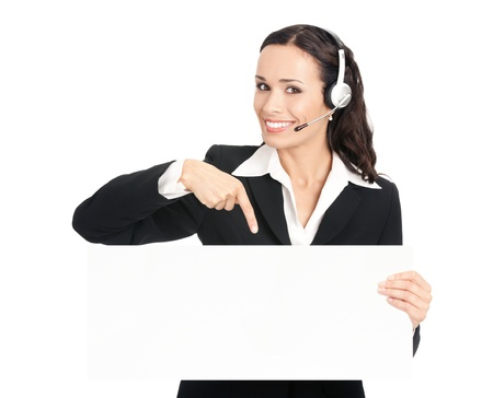 space area: Happy smiling young customer support phone operator in headset showing blank signboard, isolated on white background