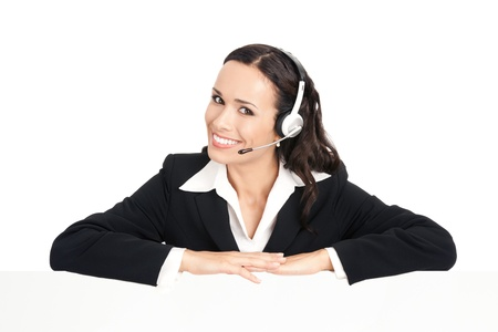 Happy smiling young customer support phone operator in headset showing blank signboard, isolated on white background Stock Photo - 10468005