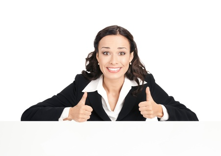 Happy smiling young business woman showing blank signboard, isolated over white background photo