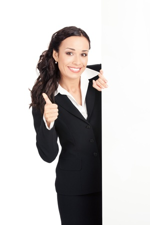 sales executive: Happy smiling young business woman showing blank signboard, isolated over white background