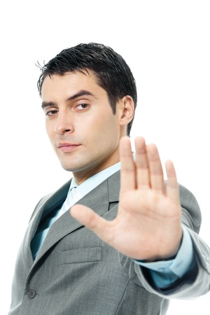 permission: Serious young business man showing stop gesture, isolated over white background