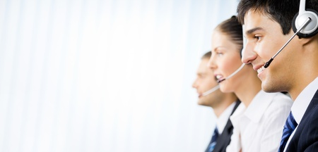 Three happy customer support phone operators at office Stock Photo - 10468129