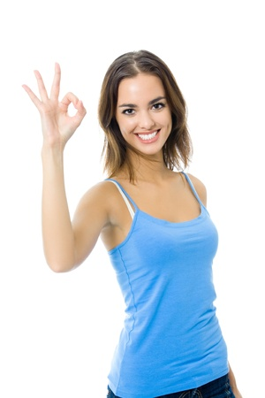 sports wear: Young happy smiling cheerful woman in sports wear showing OK gesture, isolated on white background