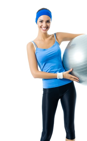 Young happy smiling woman with fitness ball, isolated on white background photo