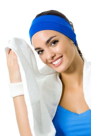 wellness center: Portrait of happy smiling young woman in fitness wear with towel, isolated on white background
