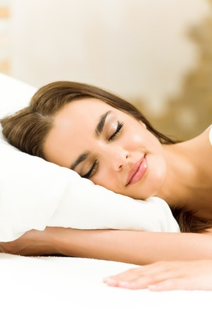 cushion: Young happy beautiful woman sleeping at home