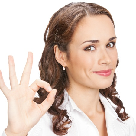 okay: Happy smiling beautiful young business woman showing okay gesture, isolated over white background Stock Photo
