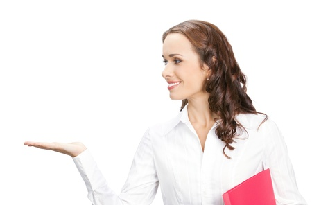 Happy smiling young beautiful business woman showing blank area for sign or copyspase, isolated over white background photo