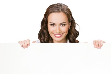 Happy smiling beautiful young business woman showing blank signboard, isolated over white background photo