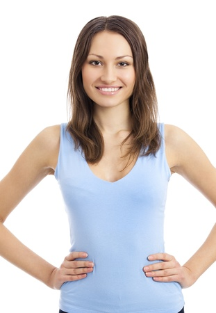 Portrait of beautiful young happy smiling woman in fitness wear, isolated over white background photo