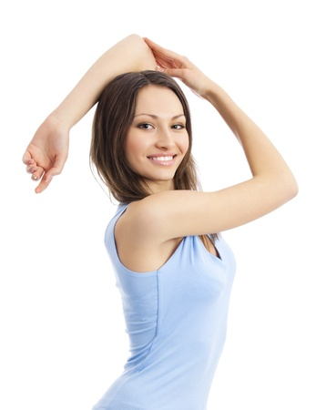 Portrait of young happy smiling woman doing fitness exercise, isolated over white background  photo