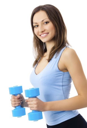 dumbbells: Portrait of young happy smiling woman in sportswear, doing fitness exercise with dumbbells, isolated over white background Stock Photo