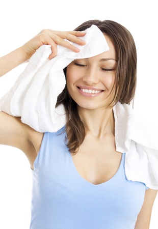 leisure centre: Portrait of happy smiling young woman in fitness wear with towel, isolated over white background Stock Photo