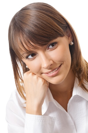 Happy smiling cheerful thinking or planning young business woman, isolated over white background photo