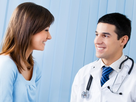 Happy doctor and patient at office Stock Photo - 10993743