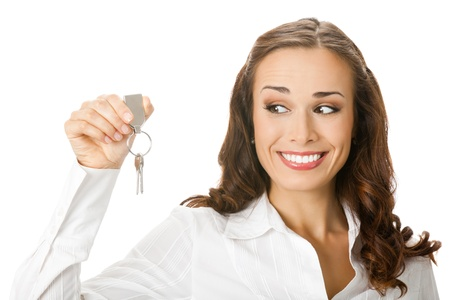 Young happy smiling business woman or real estate agent showing keys from new house, isolated on white background Stock Photo - 10993662