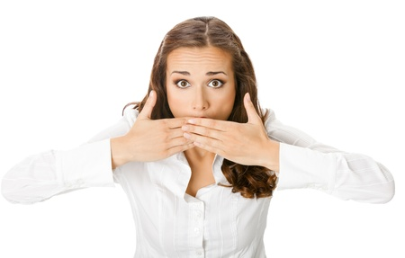 Portrait of happy smiling young business woman covering with hands her mouth, isolated over white background photo