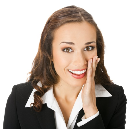 rumor: Portrait of happy smiling young business woman covering with hand her mouth, isolated on white background