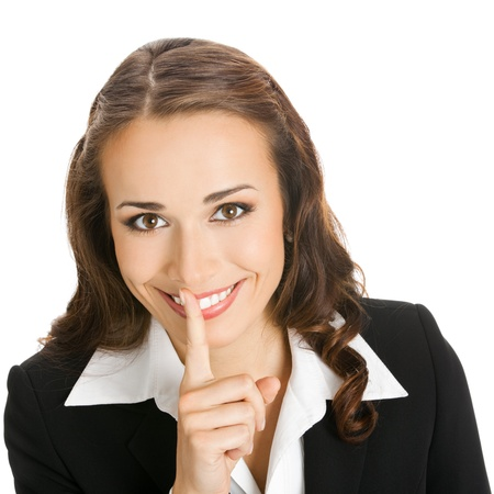keeping: Portrait of young happy smiling business woman keeping finger on her lips and asking to keep quiet, isolated over white background