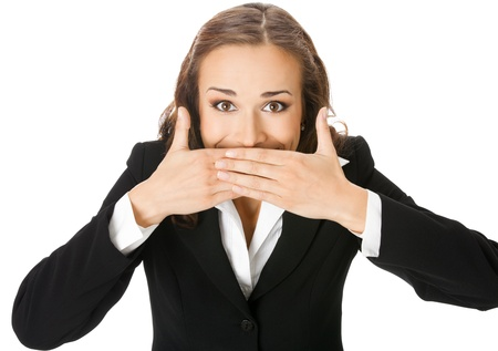hand over: Portrait of happy smiling young business woman covering with hands her mouth, isolated over white background