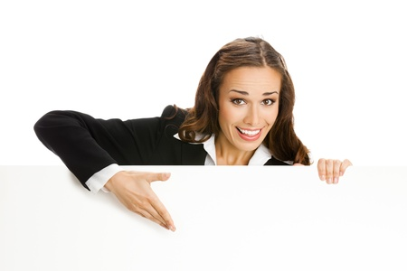 sales executive: Happy smiling young business woman showing blank signboard, isolated on white background Stock Photo