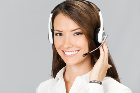Portrait of happy smiling cheerful customer support phone operator in headset, over grey background Stock Photo - 11080307