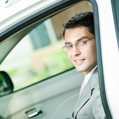 Portrait of young happy smiling businessman in the car Stock Photo - 11143865