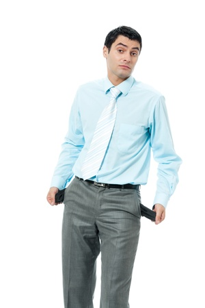 empty pockets: Young unhappy, sad and broke business man showing empty pants pockets, no cash, isolated over white background