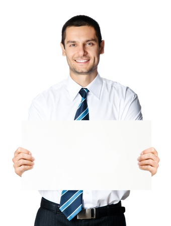 Portrait of happy smiling young business man showing blank signboard, isolated over white background photo